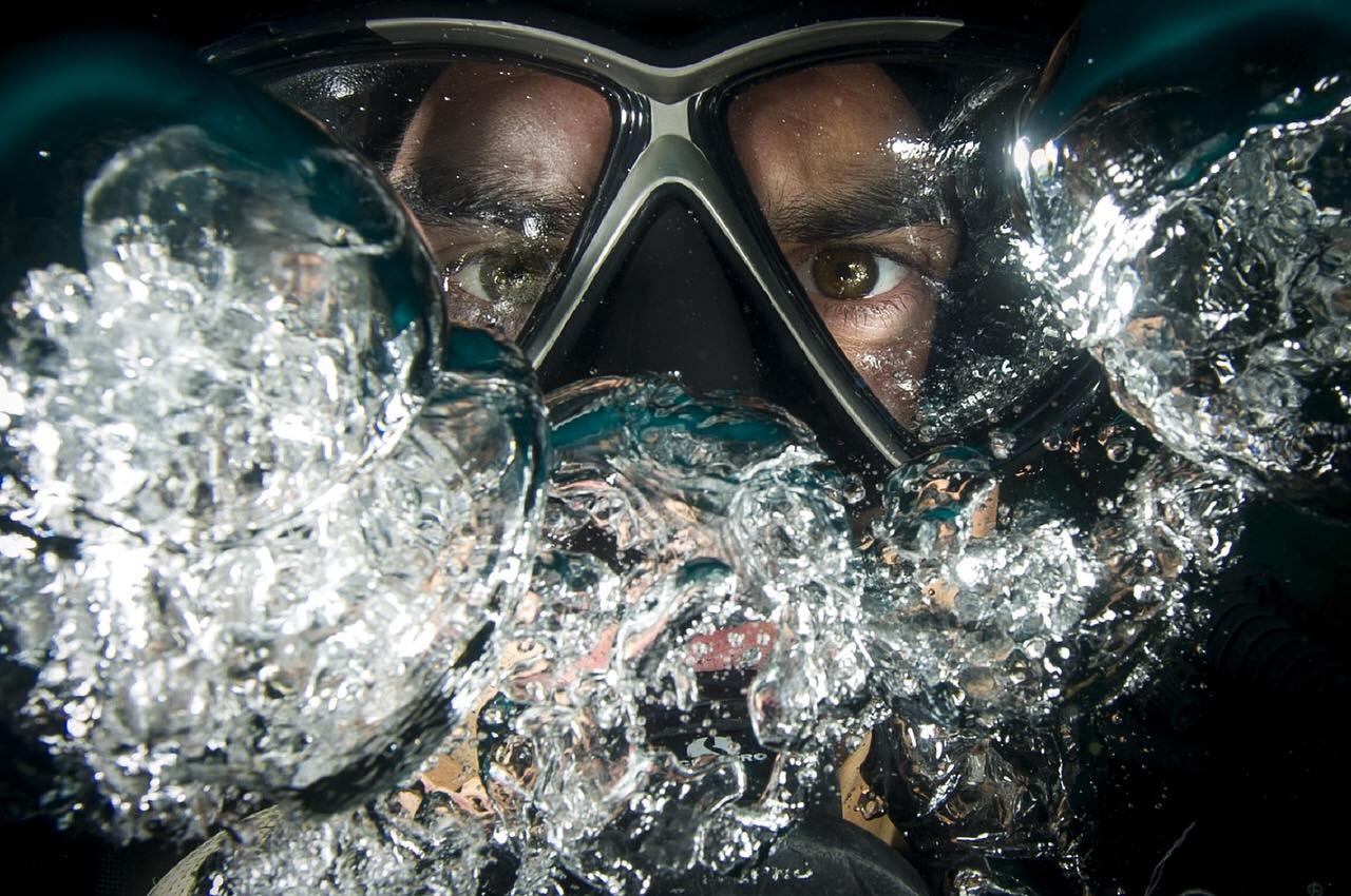 Diver blowing bubbles