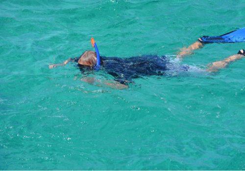 Man snorkelling in clear water